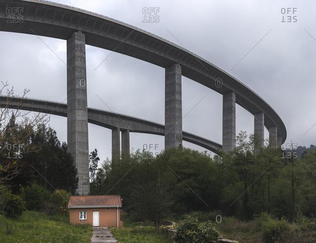 High viaduct under gloomy sky