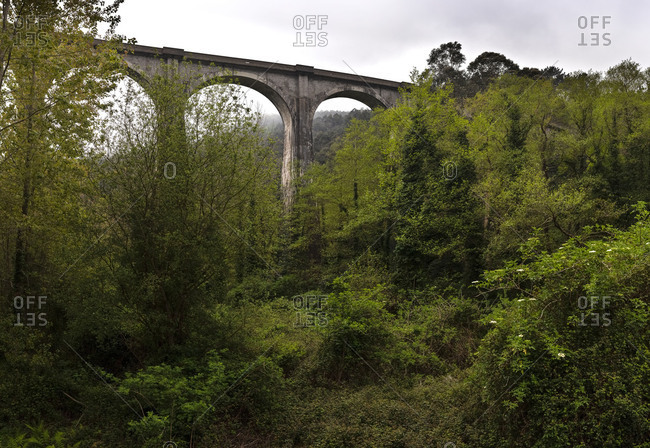 Majestic high viaduct under cloudy sky