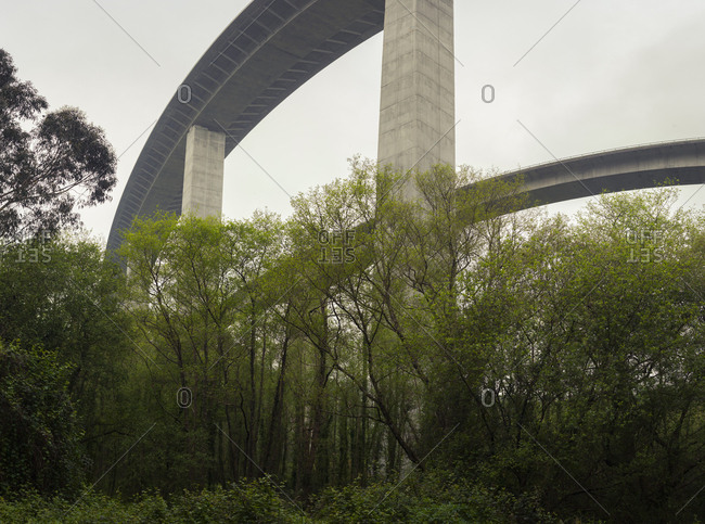 Beautiful white viaduct with trees below