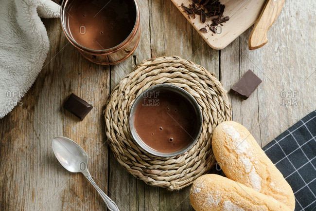 Hot chocolate cup on a wood surface top view
