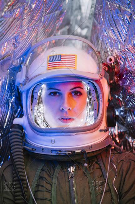 Girl wearing old space helmet