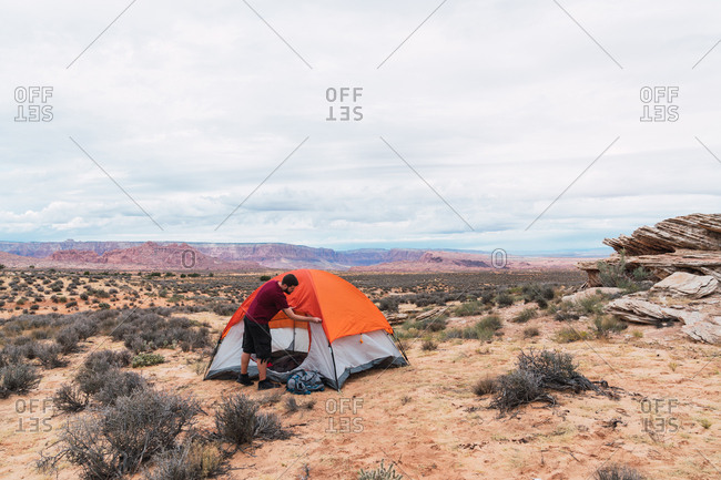 Traveler packing backpack and closing tent