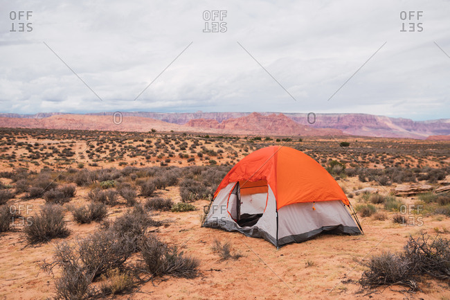 Empty tourist tent standing in middle of magnificent desert on cloudy day