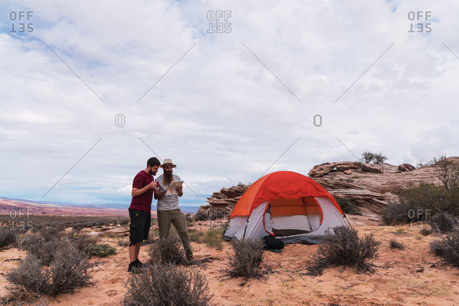 Travelers at tent with map in Grand Canyon