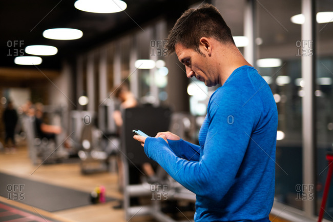 Man using mobile phone in gym