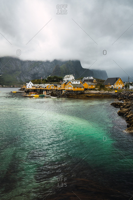 Picturesque aerial view of small village on rocky shore