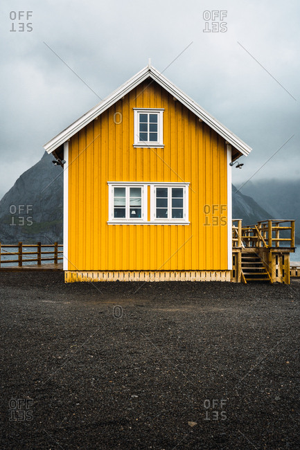 Yellow house with mountains behind