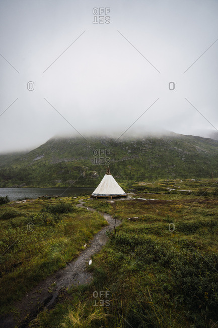 Tent placed on ground near mountain