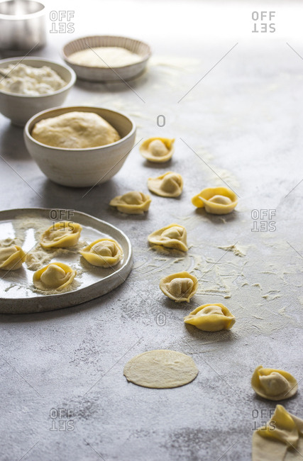 Raw tortellini on table in flour