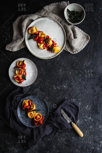 Top view of served tortellini with tomatoes