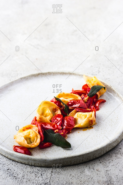 Closeup of delicious dish of tortellini and tomatoes