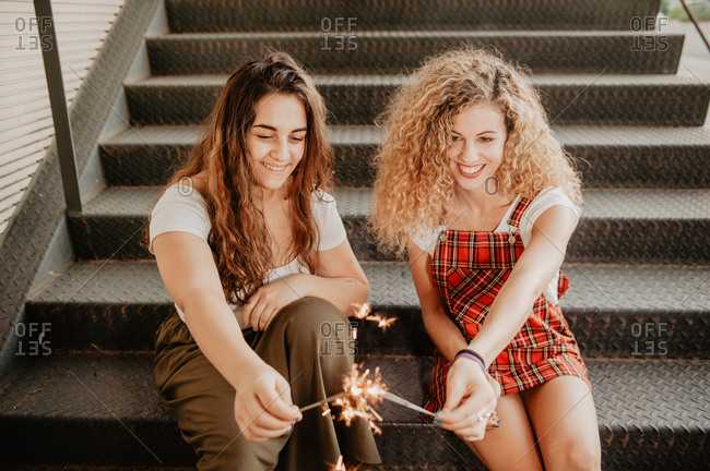 Friends with sparkles on steps