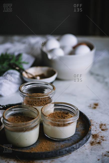 Jars with custard and chocolate desert