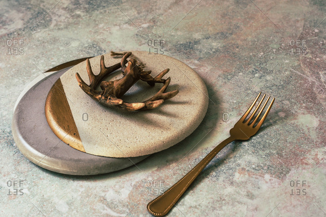 Christmas table set, concrete plates made by hand, decorated with the figure of a deer, white and gold colors
