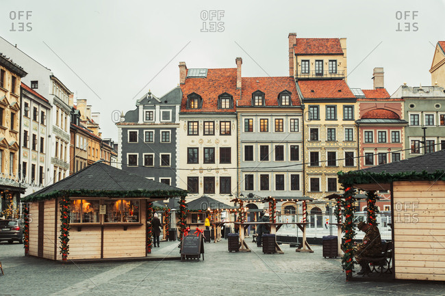 WARSAW, POLAND - NOVEMBER 27, 2017: Christmas market in Warsaw Old Town Market Square, detail of the old colorful facades