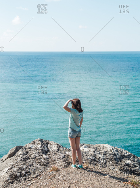 Woman standing on seascape