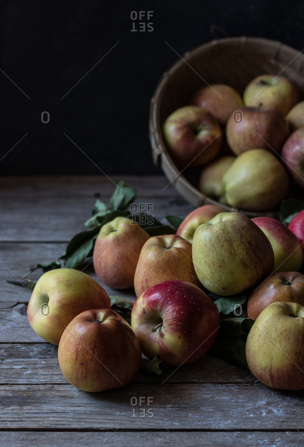 Apples and leaves near basket