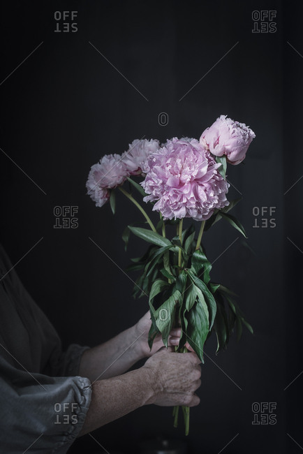 senior woman holding a Bouquet of beautiful flowers