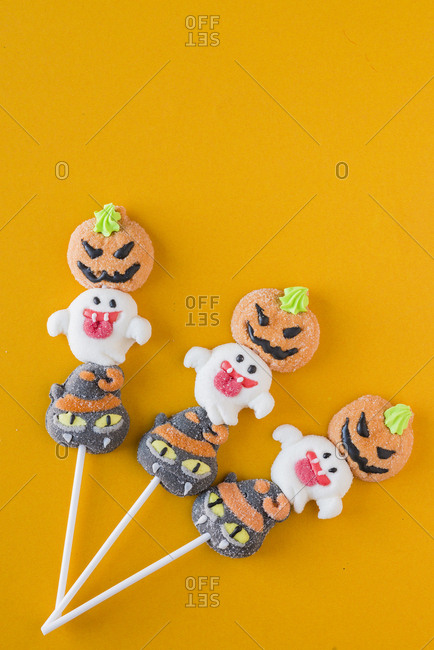 Halloween candies on an colored background