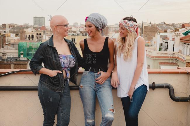 Happy women standing on rooftop
