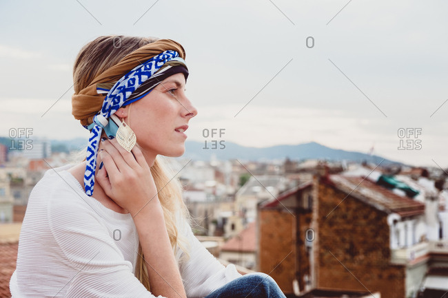 Woman in head cloth standing on rooftop