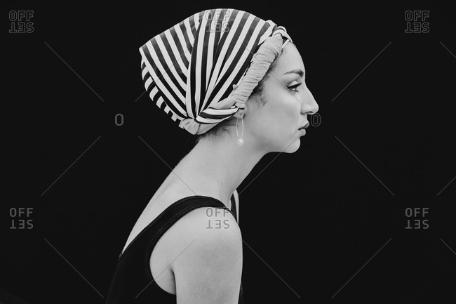 Young woman in head cloth looking at camera