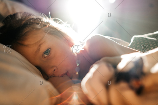 Young girl laying in bed