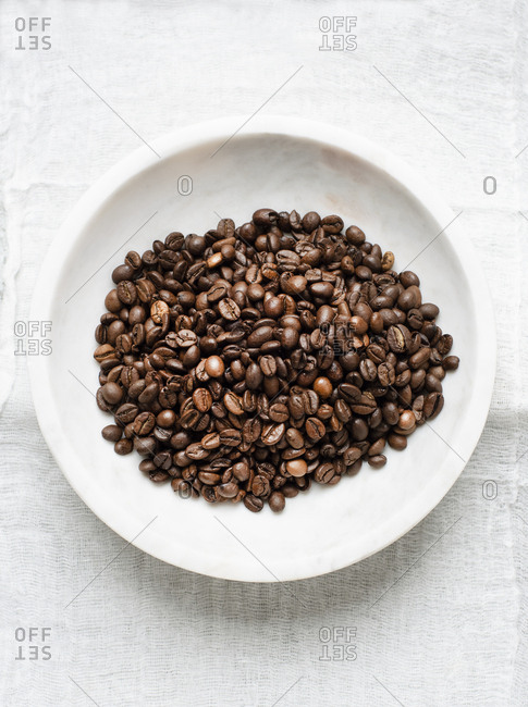 Coffee beans in marble bowl