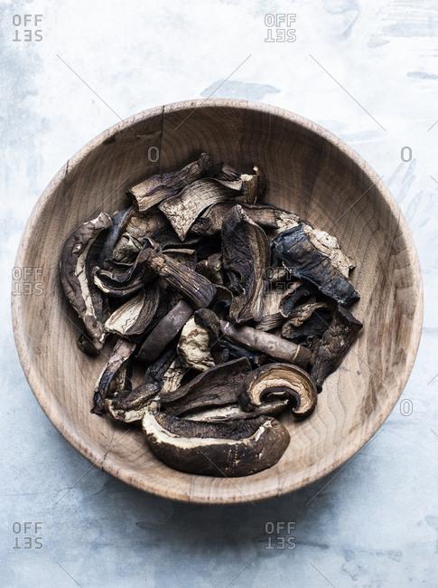 Dried mushrooms in wood bowl