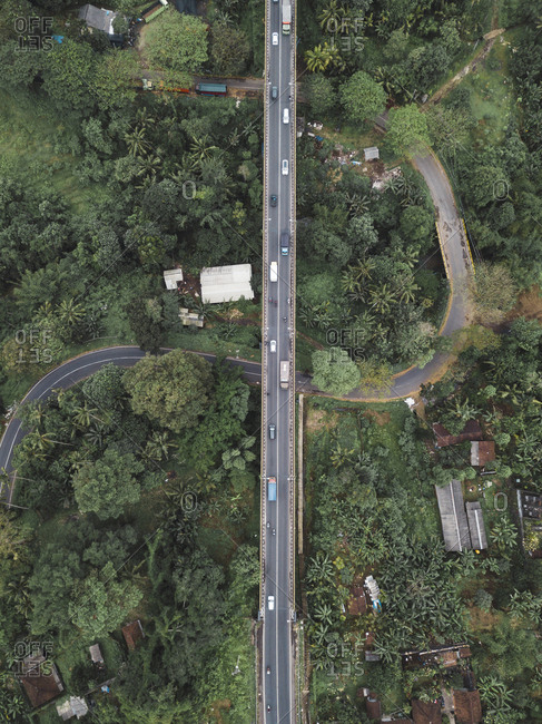 High angle view of bridge over road amidst trees in forest at Bali