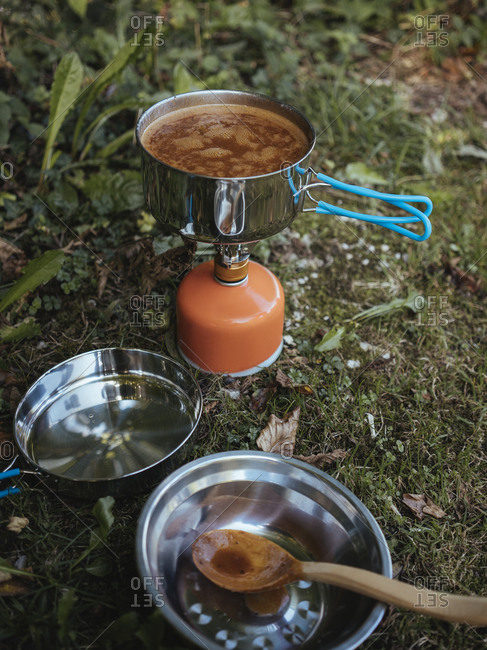 High angle view of food cooking on camping stove in forest