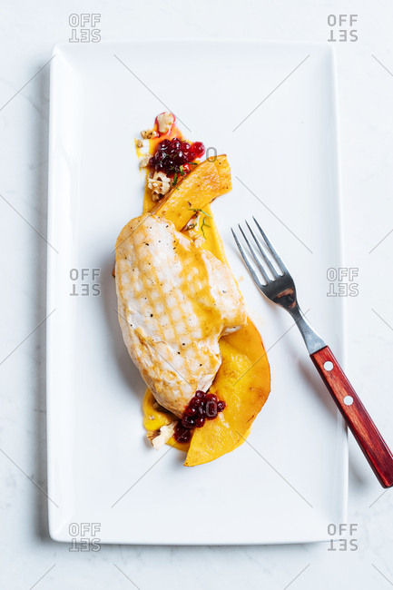 Chicken breast served with squash