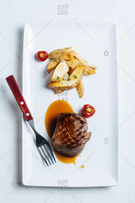 Gourmet steak served with fries