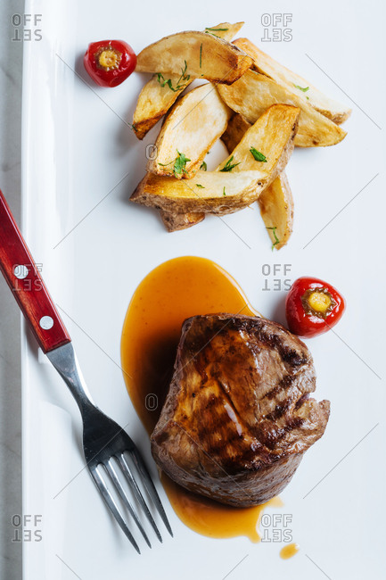 Juicy steak served with fries