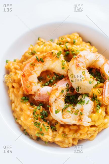 Shrimp served over flavored rice