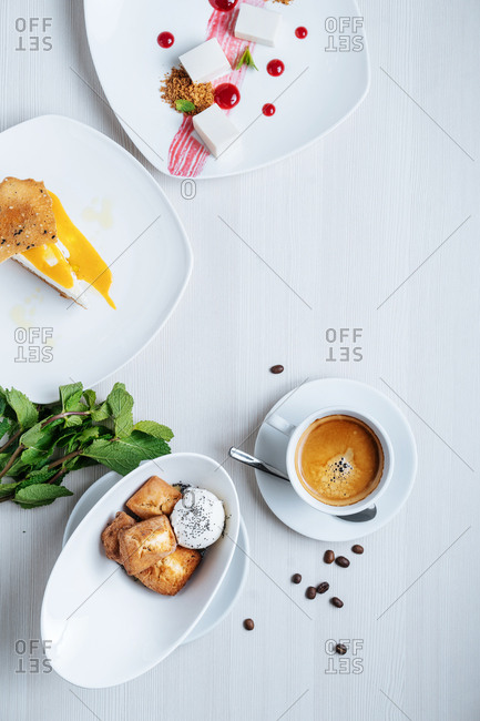 Variety of dessert dishes with coffee