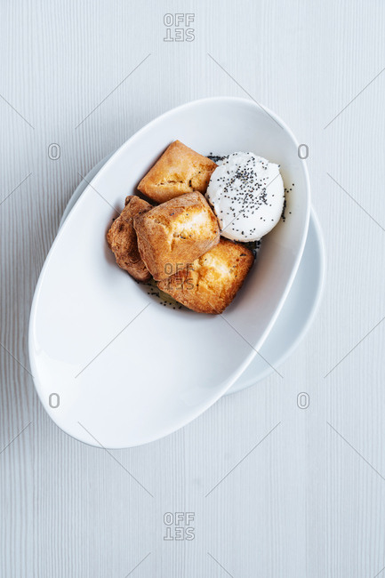 Dessert bread served with ice cream topped with poppy seeds
