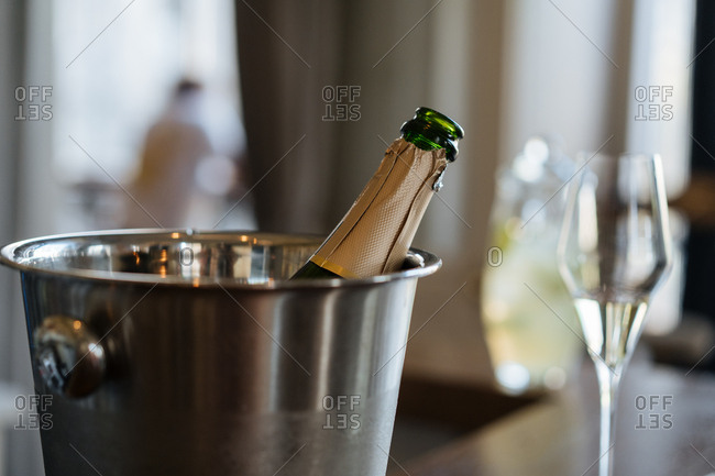 Open bottle of wine in champagne bucket