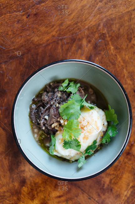 Beef dish served in bowl with broth