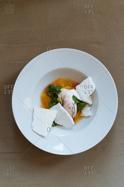 Bowl with poached egg and fresh cheese