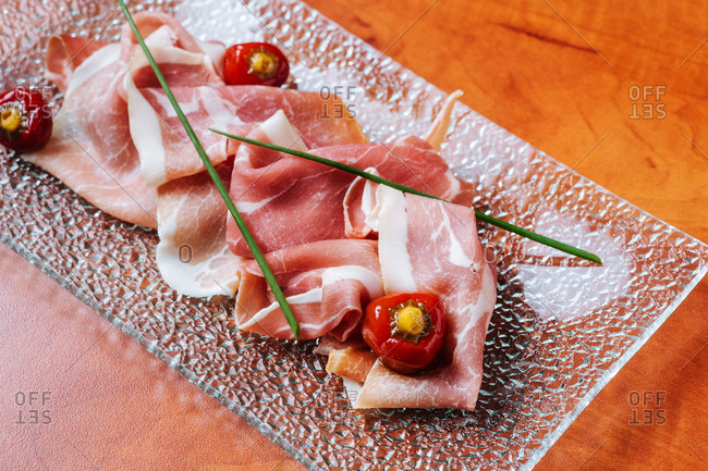 Thinly sliced ham served with peppers