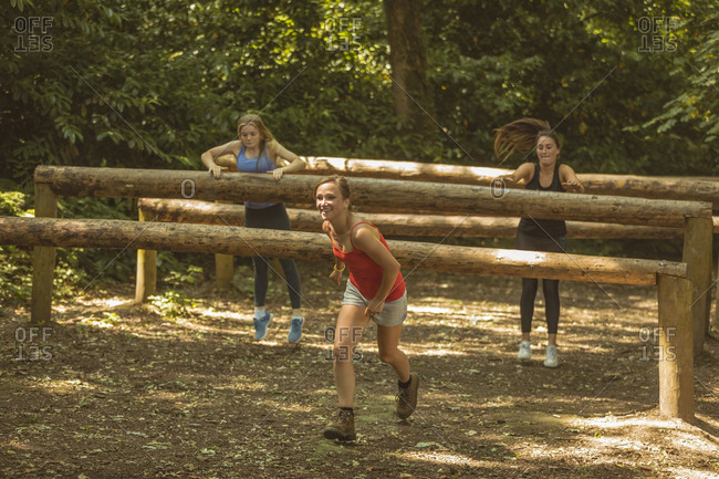 Fit women training over obstacle course at boot camp