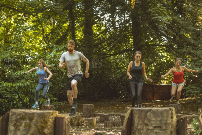 Fit people training over obstacle course at boot camp