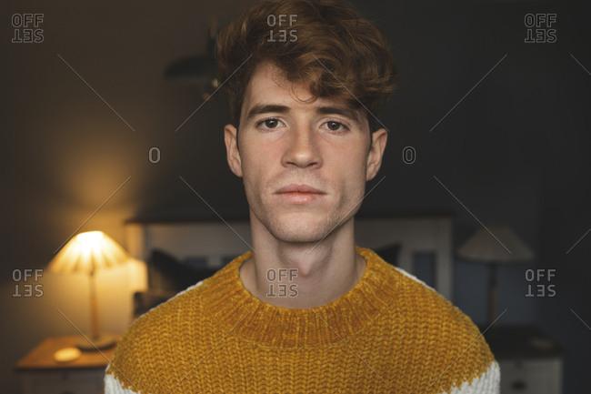Portrait of man standing in bedroom at home