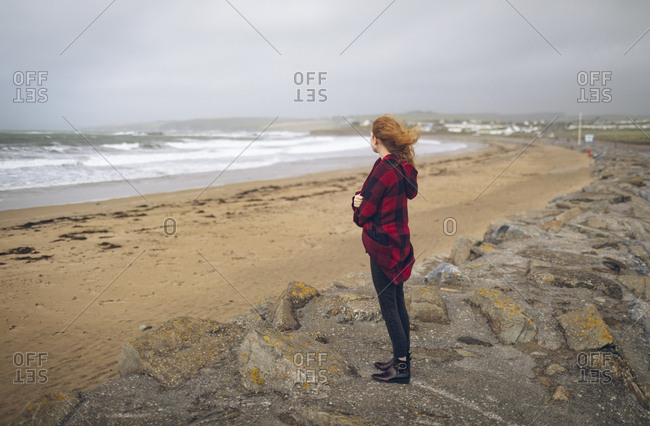 Thoughtful woman standing in the beach