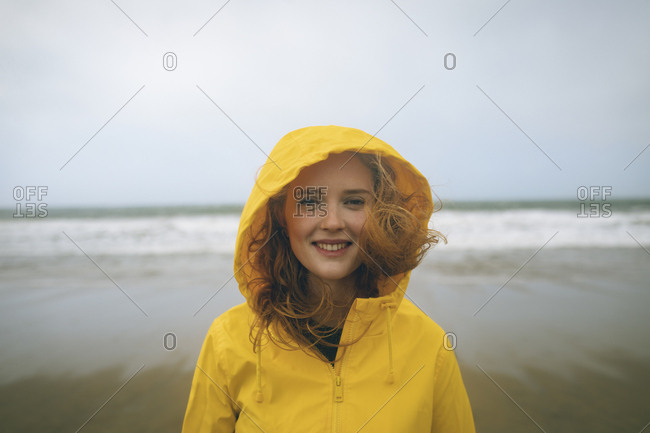 Portrait of redhead woman standing in the beach