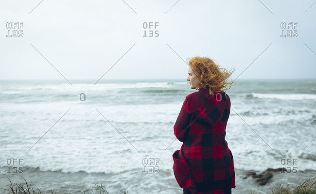 Rear view of woman standing in the beach