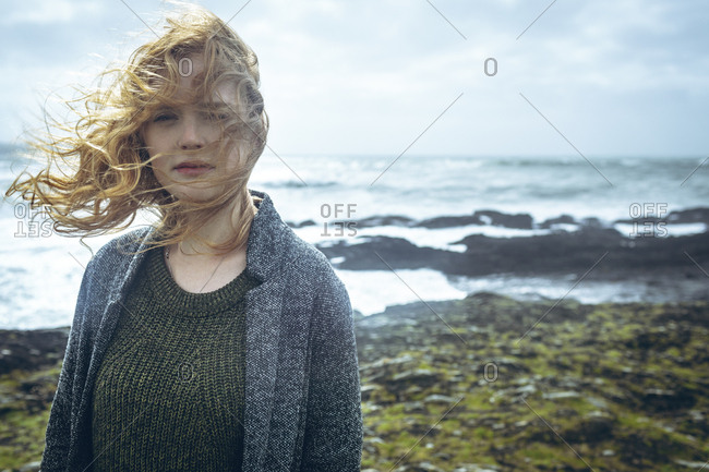 Portrait of woman standing in the beach