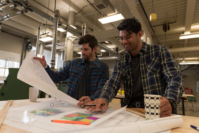 Two smart craftsman working in workshop