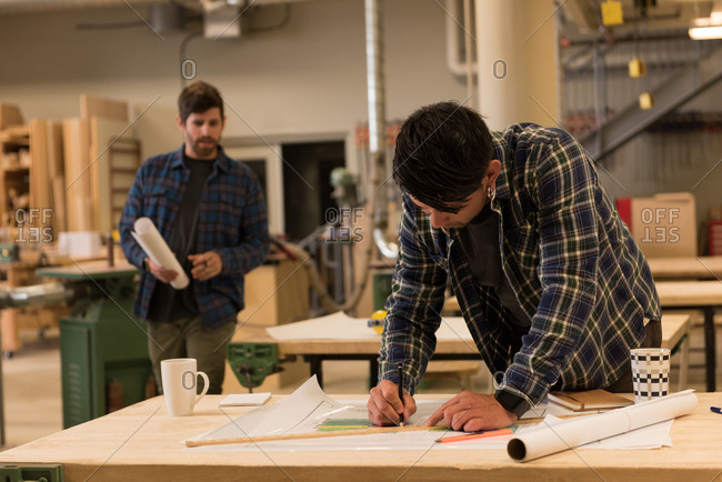 Attentive craftsman working in workshop